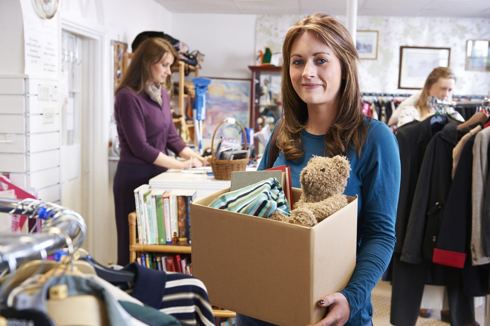 https://www.shutterstock.com/image-photo/woman-donating-unwanted-items-charity-shop-341522720
