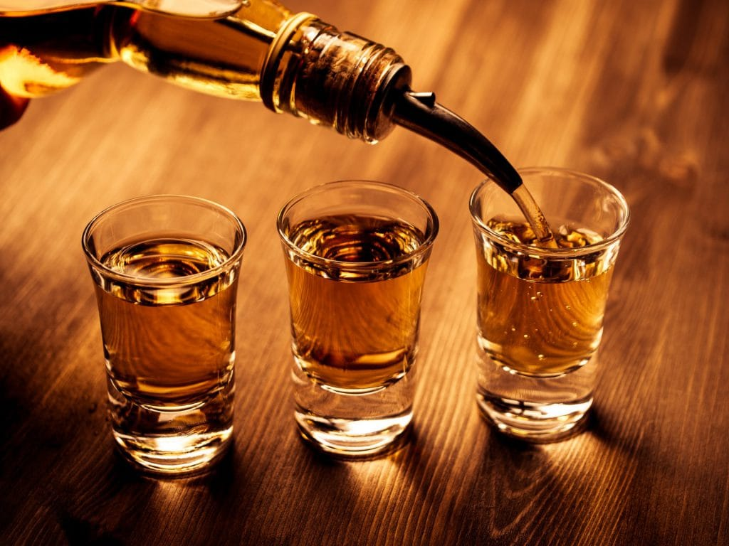 https://www.shutterstock.com/image-photo/three-shot-glasses-being-filled-drink-262350209